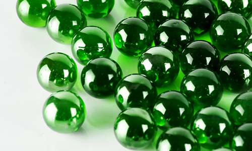 green-glass-round-marbles